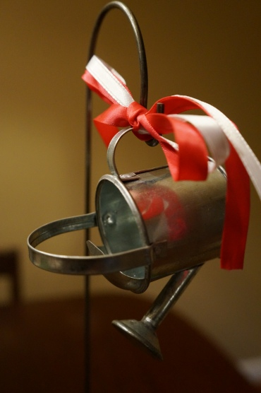 Miniature watering can with ribbon