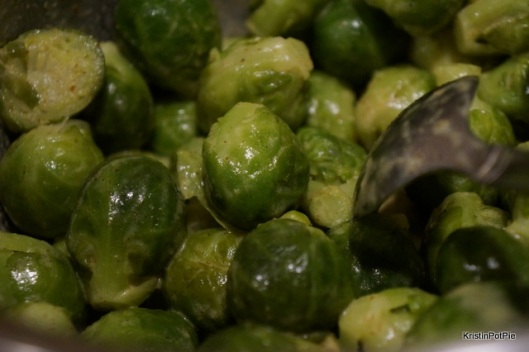Place sprouts in a saucepan and cover with water, bring to a boil and boil for five minutes. While the sprouts are boiling prepare the glaze, place butter and mustard in a microwave proof bowl and cook on med in the micrwave until butter is melted about 20-30 seconds wisk the butter and mustard to a smooth paste. When Brussels sprouts are done boiling, drain them and add the butter/mustard mixture to the saucepan with the sprouts. coat them evenly and then pour out onto a baking sheet. Bake in the oven at 425 for 25-30 minutes until the are nice and carmelized - be sure to shake the sheet around at the halfway point.